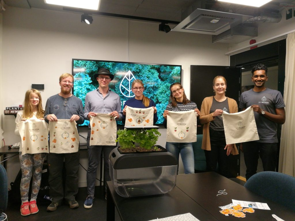 ecobloomers proudly displaying tote bags